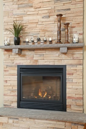 gas-fireplace-with-ledgestone-surround - Main Eco Homes
